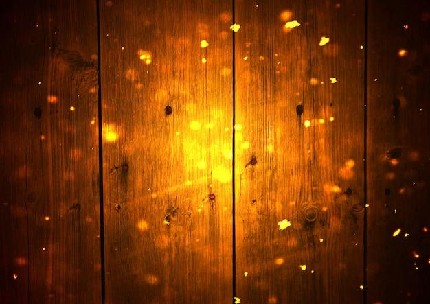 Hintergrund von holzbrettern mit schnee- und glitzer-bokeh-effekt.