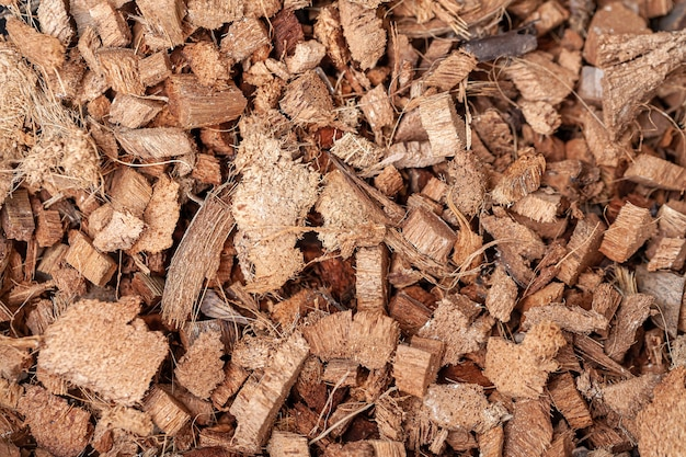 Hintergrund von kokosfaserschalen, die für blumenerdemischungen für pflanzen oder terrarienböden verwendet werden