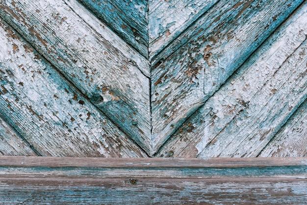 Hintergrund von schäbigen blauen hölzernen planken, zusammen genagelt in verschiedene richtungen.