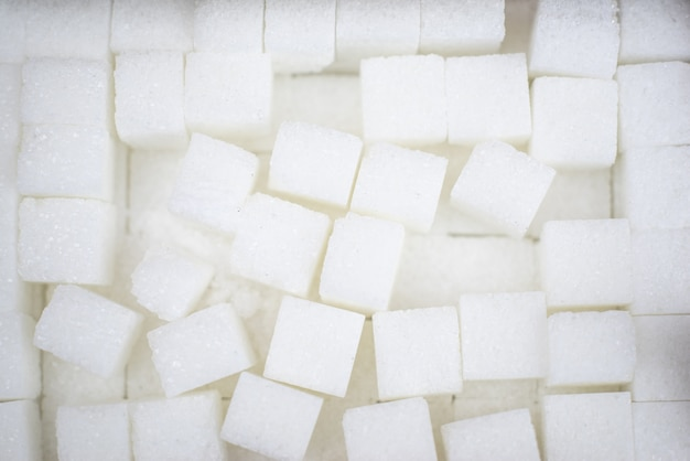 Hintergrund von zuckerwürfeln. draufsicht oder flache lage selektiver fokus