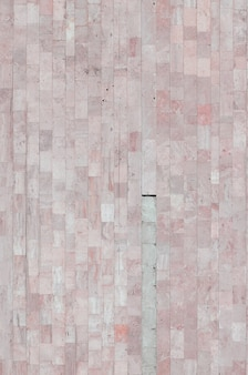 Hintergrundbeschaffenheit der alten beige marmorwand von einer vielzahl von großen fliesen
