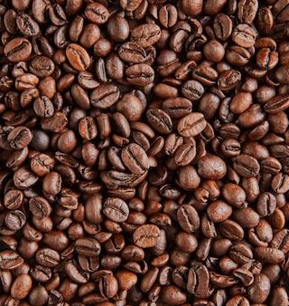 Hintergrundbeschaffenheit der körner des köstlichen italienischen kaffees.