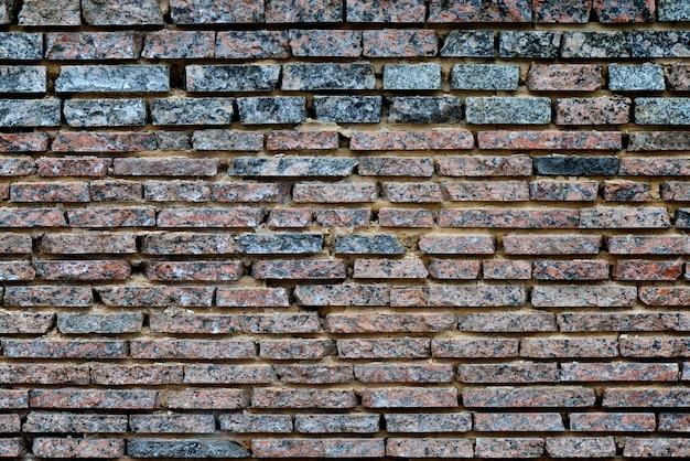 Hintergrundbeschaffenheit der mehrfarbigen backsteinmauer. beschaffenheits- und hintergrundkonzept.