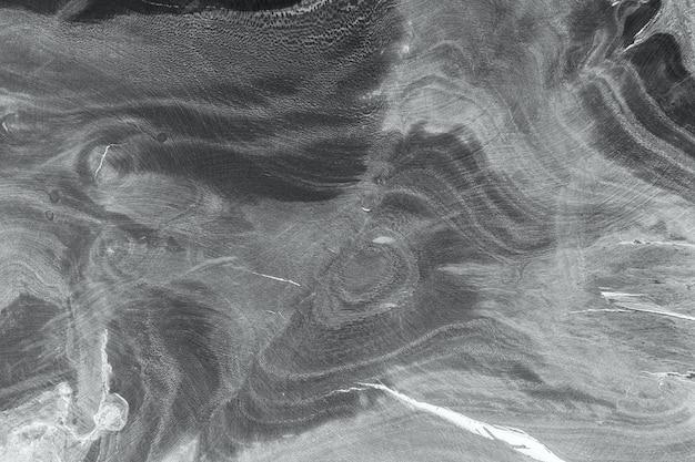 Hintergrundbeschaffenheit des natürlichen holzes. querschnitt des baumstammes schließen. alter baumstumpf textur hintergrund. schwarzweißfotografie