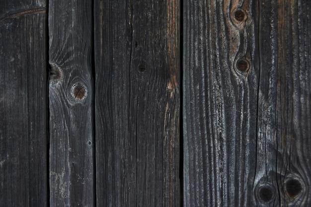 Hintergrundbeschaffenheit einer wand der alten hölzernen protokolle und der bretter
