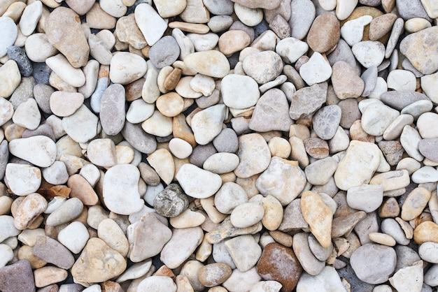 Hintergrundbeschaffenheit mit steinen eines meeres. abstraktes muster mit flussstein