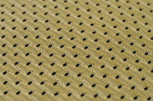 Hintergrundbild einer gewebebeschaffenheit eines gelben trikots hergestellt