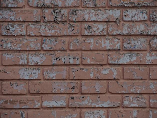 Hintergrundblockbacksteinmauer mit alten flecken.