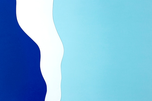 Hintergrunddesign des blauen und weißen papiers