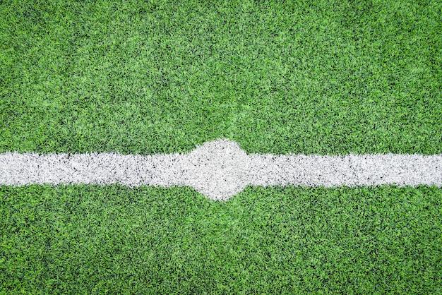 Hintergrundsport des grünen grases des fußballplatzes futsal-feldes im freien