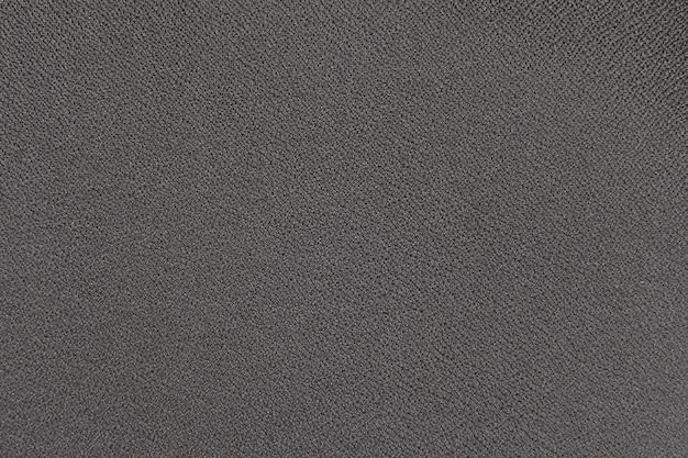 Hintergrundstrukturfragment des möbelpolsters schwarz.