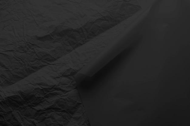 Hintergrundtextur des zerknitterten schwarzen papiers.