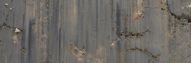Hintergrundtextur von der glatten oberfläche des sand- und erdbodens. draufsicht. banner
