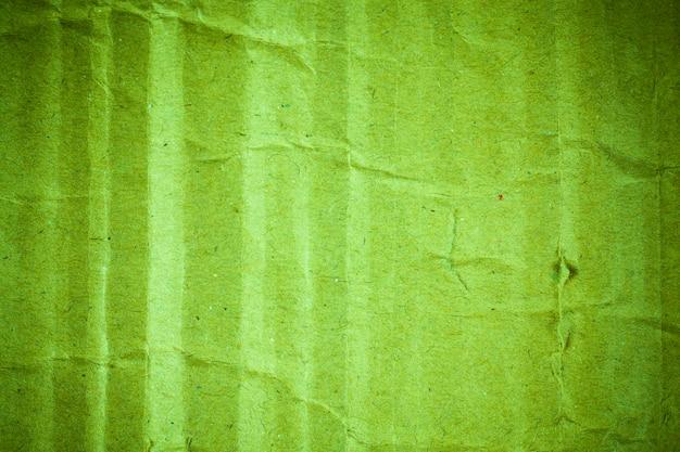 Hintergrundvignette aus grünem kartonpapier