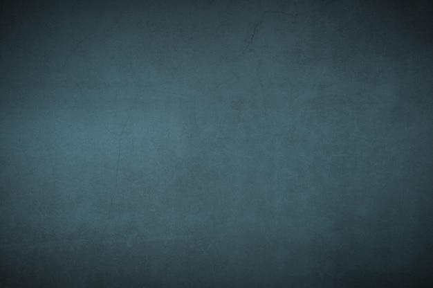 Hintergrundwand des gealterten strukturierten alten gipsblaus.