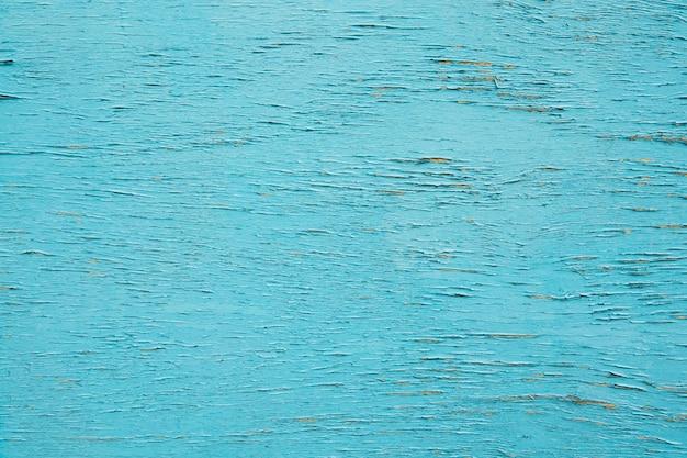 Hölzerne beschichtung der weinlese im blaue farbblauholzhintergrund