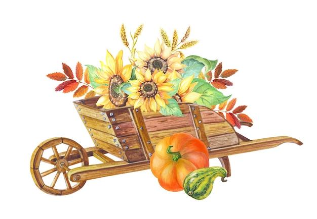 Hölzerne gartenschubkarre mit weizen, sonnenblume. herbstkürbis