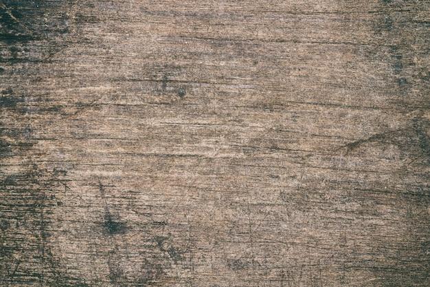 Hölzerne tabelle der weinleseoberfläche und rustikaler kornbeschaffenheitshintergrund. schließen sie oben von der dunklen rustikalen wand.