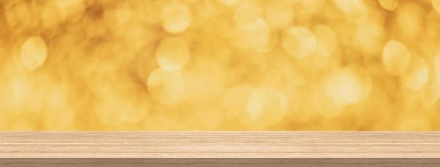 Hölzerne tischplatte, abstrakter hintergrund des goldfunkelns bokeh für produkt- und anzeigenmontageverbot