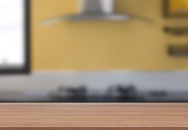 Hölzerne tischplatte mit modernem gelbem küchenrauminnenraum