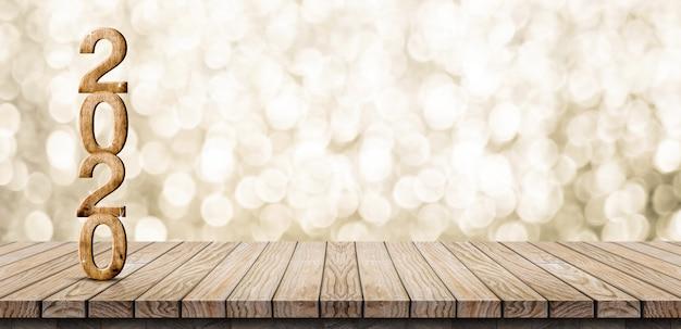 Hölzerne zahl des guten rutsch ins neue jahr 2020 auf hölzerner tabelle mit funkelnder gold-bokeh wand