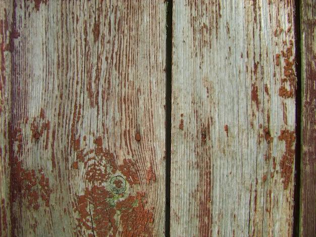 Hölzerner hintergrund der alten hölzernen gemalten beschaffenheitsoberfläche mit abblätternder farbe.