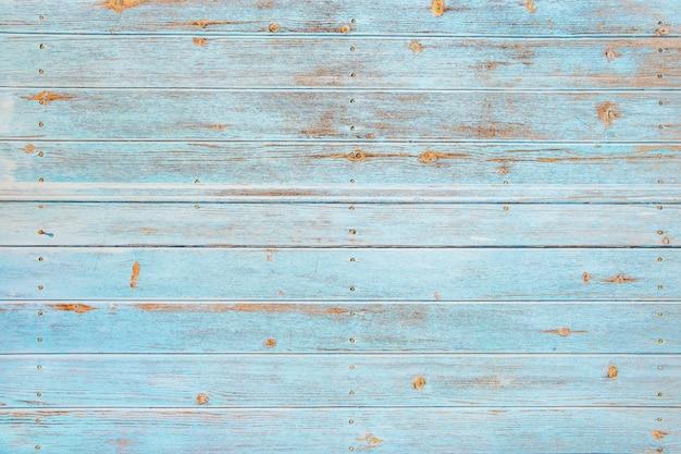 Hölzerner hintergrund des weinlesestrands - alte verwitterte hölzerne planke gemalt im türkis oder in der blauen seefarbe.