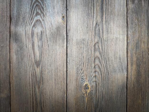 Hölzerner materieller plankenhintergrund. verwittertes hartholz mit altersspuren und rostigen nägeln