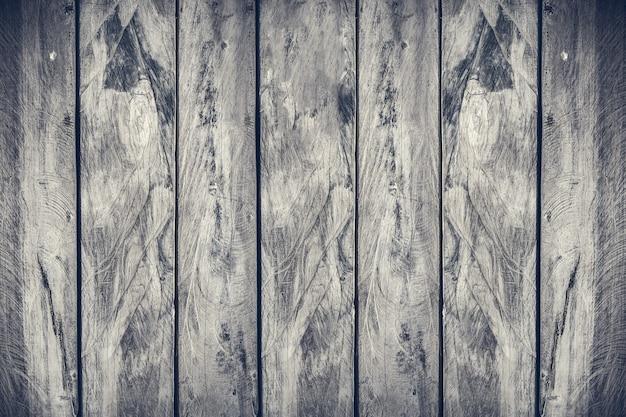 Hölzerner planken-beschaffenheitshintergrund des vertikalen aliagnment, drastischer grauton gefiltert