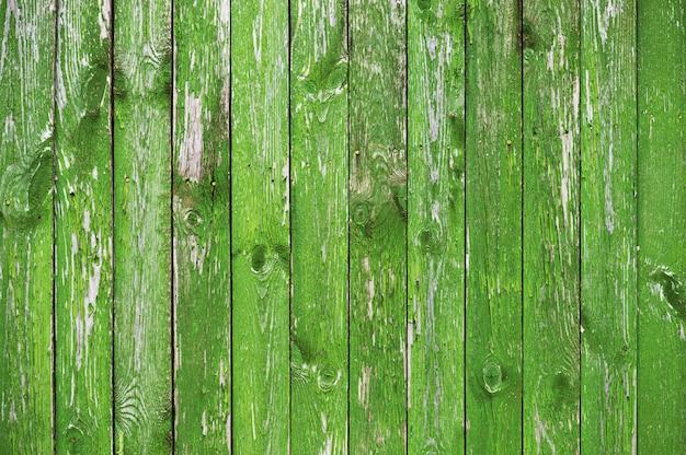 Hölzerner strukturierter hintergrund von hellgrünen brettern