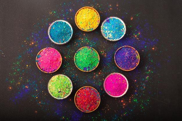 Holi farbpulver. bio gulal farben in der schüssel Premium Fotos