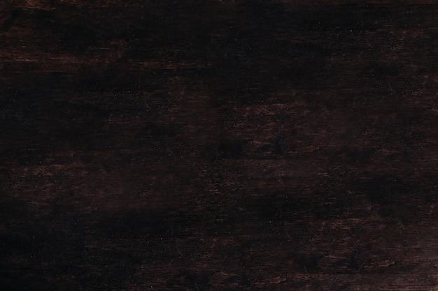 Holz dunkle hintergrundbeschaffenheit. leer für design. brauner holztisch. platz für text