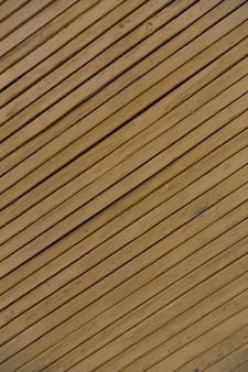 Holzbeschaffenheitshintergrund, schmutzige gelbe farbe der hölzernen planken foto in hoher qualität