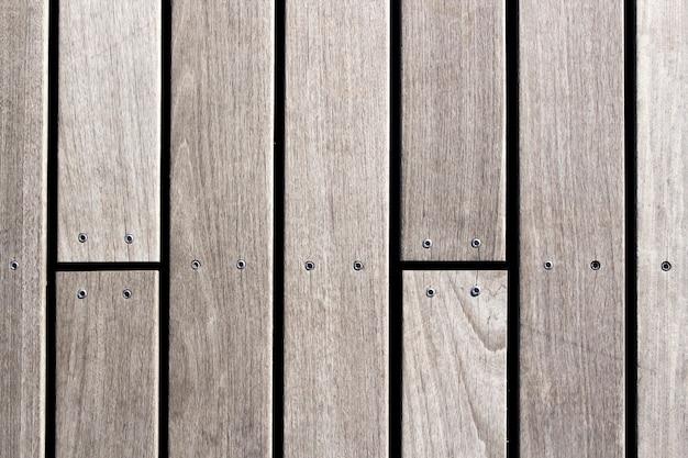 Holzbretter mit schraubenhintergrundfotobeschaffenheit