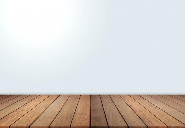 Holzfußboden und weiße wand, leerer raum für hintergrund. großer leerer raum in der gutshofart mit bretterboden, weiße wand
