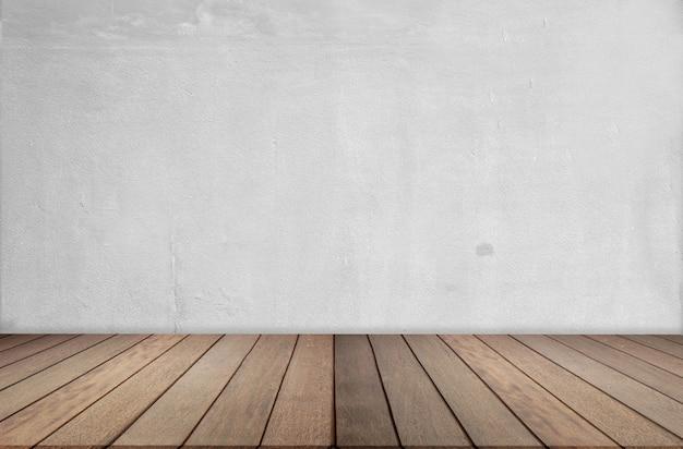 Holzfußboden und zementwand, leerer raum für hintergrund. großer leerer raum in der gutshofart mit bretterboden