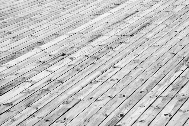 Holzfußbodenhintergrund mit schrauben