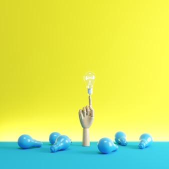 Holzhand finger zeigen auf eine glühbirne zwischen blauen glühbirnen auf dem boden.