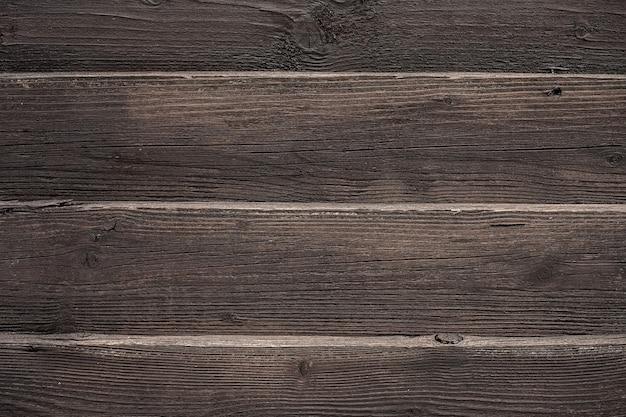 Holzhintergrund, leere oberfläche. alte bretter sind dunkelbraun. holzphotophon im rustikalen stil