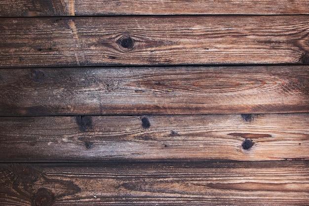 Holzstruktur mit natürlichem holzmuster für design und dekoration. dunkelbrauner holzhintergrund. natürlicher teakholzhintergrund. laminat parkettboden textur hintergrund. holz textur.