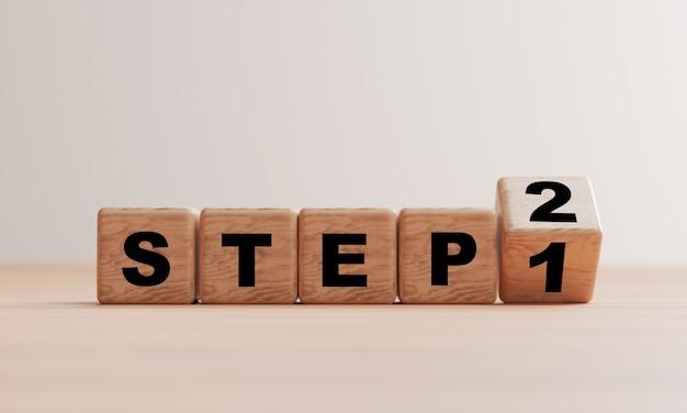 Holzwürfelblock, der schritt 1 bis 2 auf dem tisch für ein progressives projekt oder eine methode durch 3d-rendering ändert.
