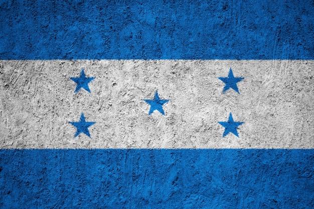 Honduras-flagge gemalt auf schmutzwand