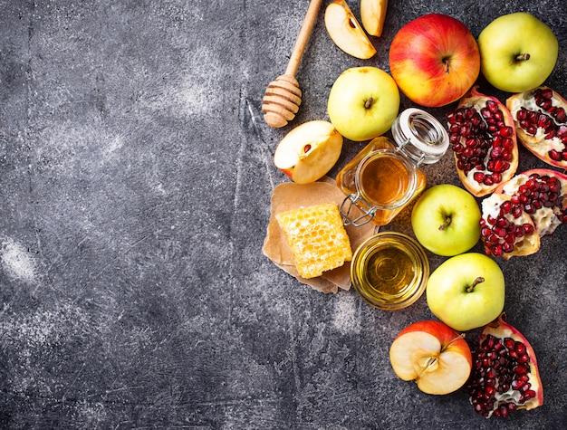 Honig, apfel und granatapfel für rosch haschana