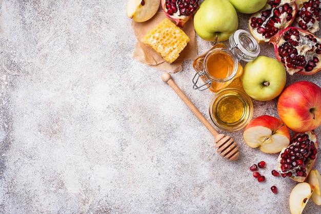 Honig, apfel und granatapfel für rosh hashana