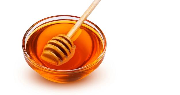 Honigstock und schüssel honig lokalisiert auf weiß mit beschneidungspfad