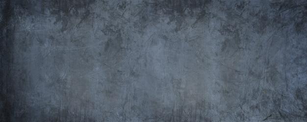 Horizontaler schwarzer zement mit grauer wand und dunkler schmutzbetontapetenwand