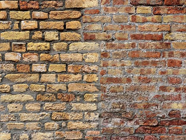 Horizontaler teil einer venezianischen alten roten backsteinmauer, hintergrund,
