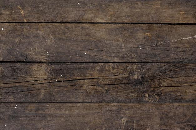Horizontales altes lackiertes hölzernes hintergrundmuster mit rissen