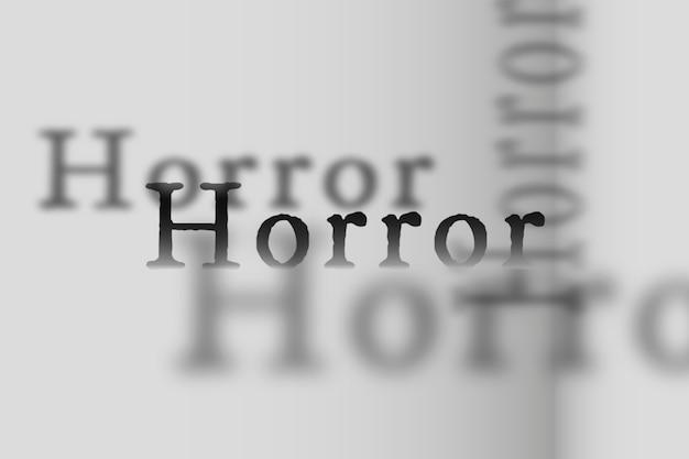 Horrorwort in verblasster schattenschrifttypografieillustration