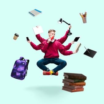 Hübscher student, mehrarmiger mann, der isoliert auf blauem studiohintergrund mit ausrüstung schwebt. konzept der beruflichen tätigkeit, arbeit, job, bildung, entwicklung. multitasking wie shiva.